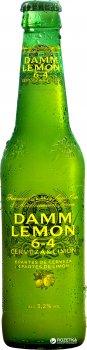 Упаковка пива Estrella Damm Lemon світле фільтроване 3.2% 0.33 л х 24 пляшки (8410793153135)